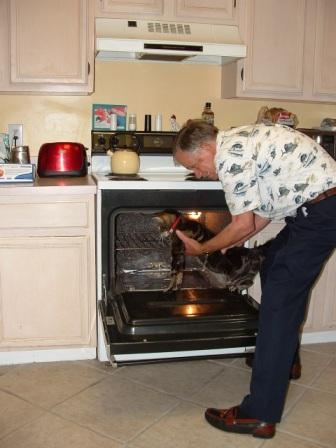 Dad caught in the act of cooking the cat!